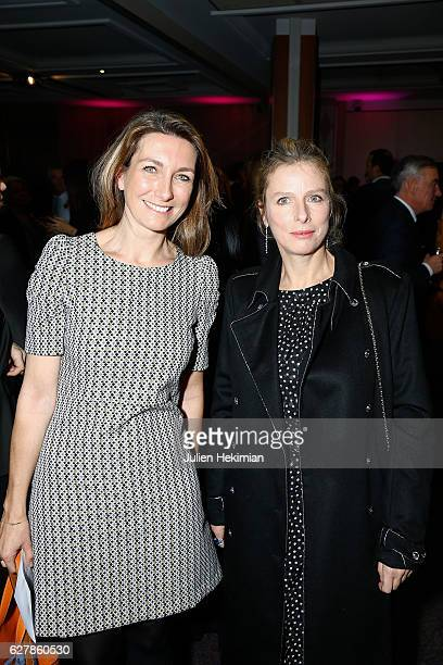 French actress Karin Viard Laureate of the prize of the woman of influence Coup de Coeur is pictured with French TV presenter Anne Claire Coudray...