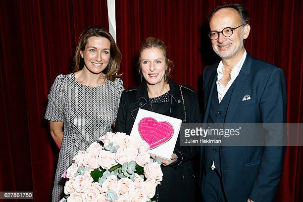 French actress Karin Viard Laureate of the prize of the woman of influence Coup de Coeur is pictured with French TV presenter Anne Claire Coudray and...