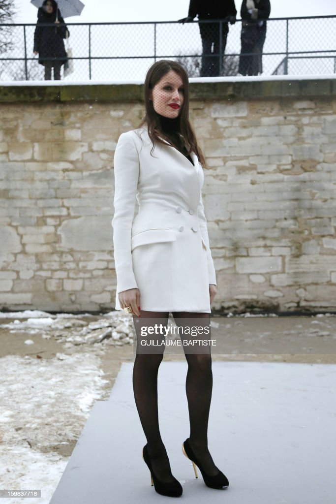 French actress Laetitia Casta arrives to attend the Christian Dior Haute Couture Spring-Summer 2013 collection show by Belgian designer Raf Simons on January 21, 2013 in Paris.