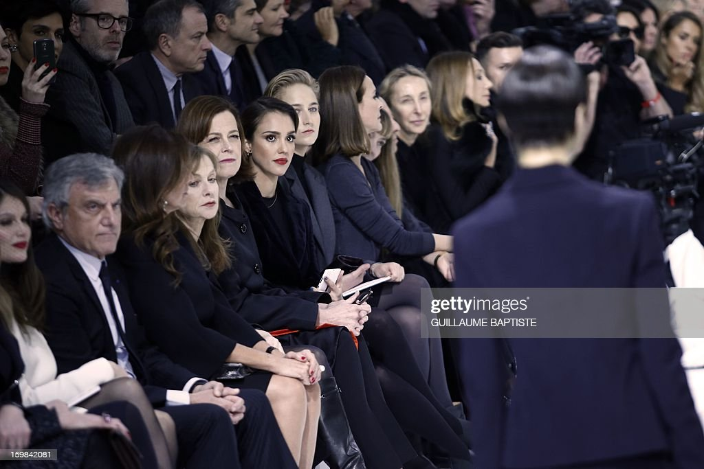 French actress Laetitia Casta, Christian Dior CEO Sidney Toledano and his wife Katia, French actress Isabelle Huppert, US actresses Sigourney Weaver, Jessica Alba and Leelee Sobieski, French actress Carole Bouquet, Tunisian-born Azzedine Alaia, French jewellery designer Victoire de Castellane, Italian fashion editor and gallerist Carla Sozzani and US actress Marisa Berenson attend the Christian Dior Haute Couture Spring-Summer 2013 collection show by Belgian designer Raf Simons on January 21, 2013 in Paris. AFP PHOTO / GUILLAUME BAPTISTE