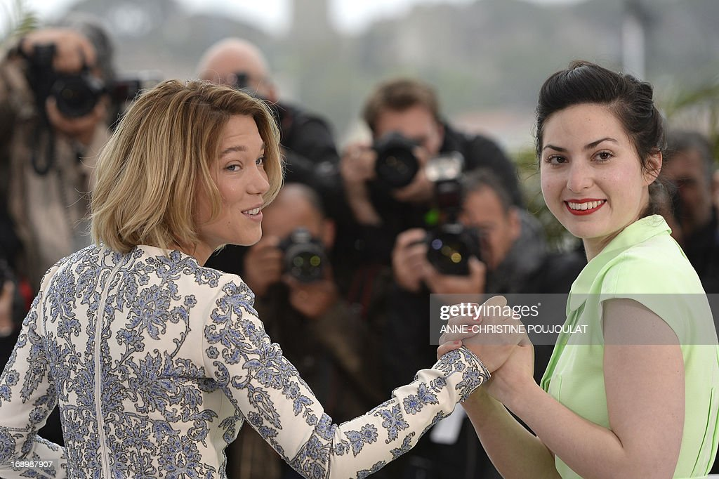 French actress Lea Seydoux (L) and director Rebecca Zlotowski hold hands on May 18, 2013 during a photocall for the film 'Grand Central' presented in the Un Certain Regard section at the 66th edition of the Cannes Film Festival in Cannes. Cannes, one of the world's top film festivals, opened on May 15 and will climax on May 26 with awards selected by a jury headed this year by Hollywood legend Steven Spielberg.