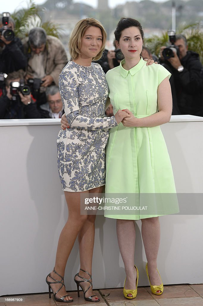 French actress Lea Seydoux (L) and director Rebecca Zlotowski hold hands on May 18, 2013 while posing during a photocall for the film 'Grand Central' presented in the Un Certain Regard section at the 66th edition of the Cannes Film Festival in Cannes. Cannes, one of the world's top film festivals, opened on May 15 and will climax on May 26 with awards selected by a jury headed this year by Hollywood legend Steven Spielberg.