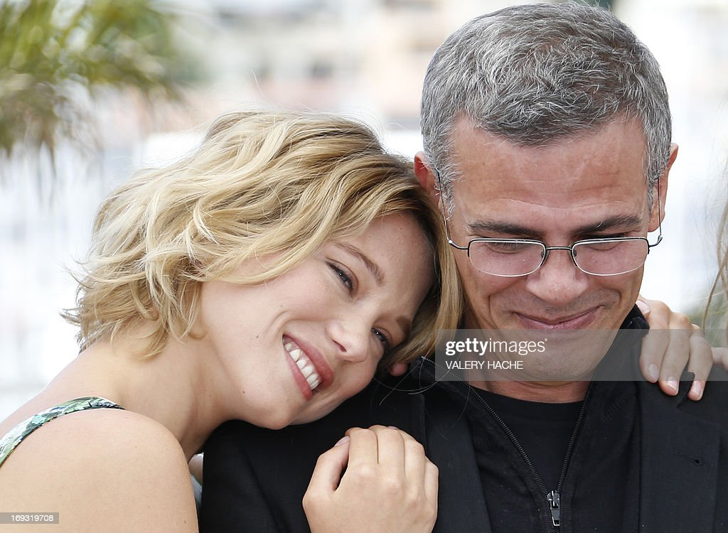 French actress Lea Seydoux (L) and French-Tunisian director Abdellatif Kechiche pose on May 23, 2013 during a photocall for the film 'Blue is the Warmest Colour' (La Vie d'Adele - Chapitre 1 & 2) presented in Competition at the 66th edition of the Cannes Film Festival in Cannes. Cannes, one of the world's top film festivals, opened on May 15 and will climax on May 26 with awards selected by a jury headed this year by Hollywood legend Steven Spielberg.