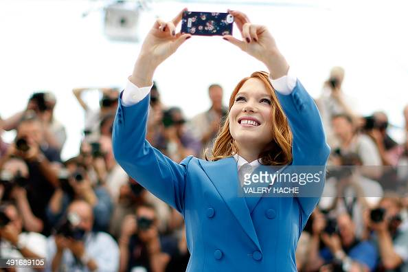 French actress Lea Seydoux poses for a selfie during a photocall for the film 'SaintLaurent' at the 67th edition of the Cannes Film Festival in...