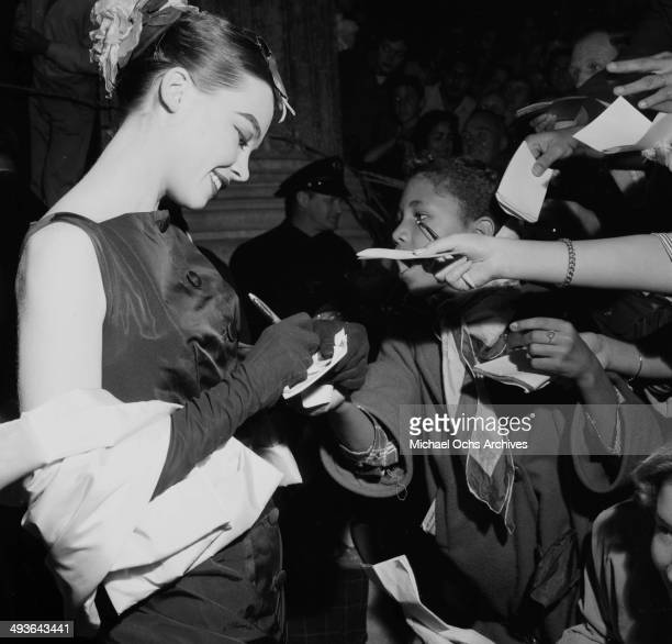 French actress Leslie Caron signs autographs before a premier in Los Angeles California