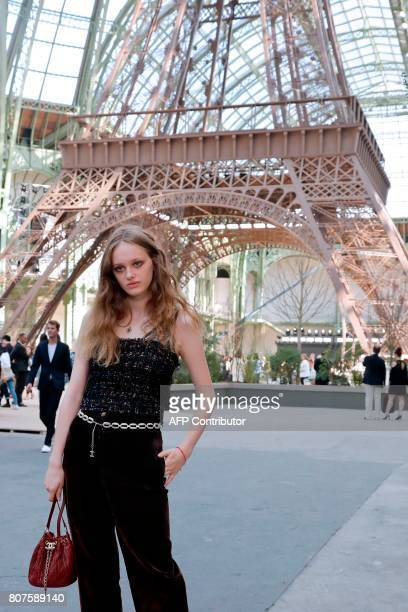 French actress Lily Taieb poses during the photocall before Chanel 20172018 fall/winter Haute Couture collection show in Paris on July 4 2017 / AFP...