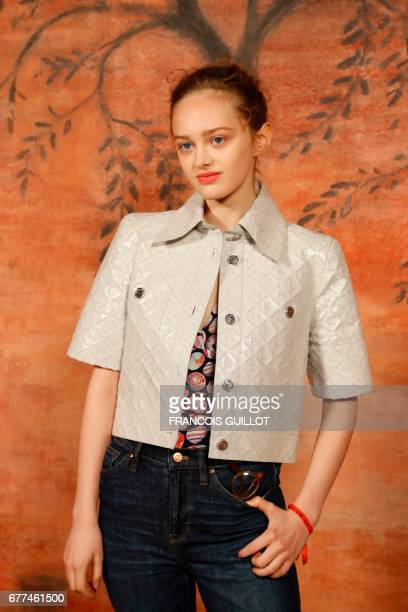French actress Lily Taieb poses during the photocall before the Chanel Croisiere fashion show on May 3 2017 at the Grand Palais in Paris / AFP PHOTO...