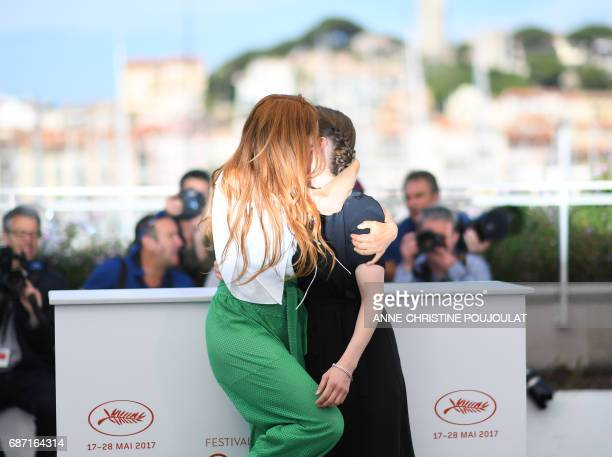 French actress Lætitia Dosch kisses French director Leonor Serraille pose on May 23 2017 during a photocall for the film 'Jeune Femme' at the 70th...