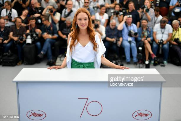 French actress Lætitia Dosch poses on May 23 2017 during a photocall for the film 'Jeune Femme' at the 70th edition of the Cannes Film Festival in...