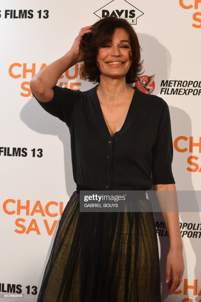 French actress Marianne Denicourt poses during the photocall for the premiere of the film 'Chacun Sa Vie' in Paris on March 13, 2017. The film is directed by French director Claude Lelouch. /