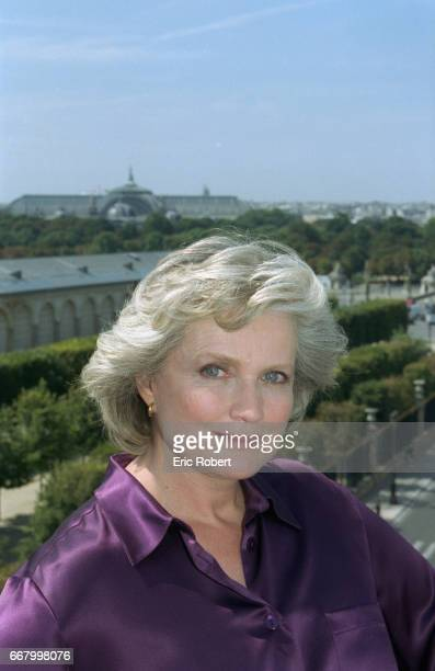 French actress MarieChristine Barrault poses on an apartment balcony overlooking the Tuileries gardens in Paris