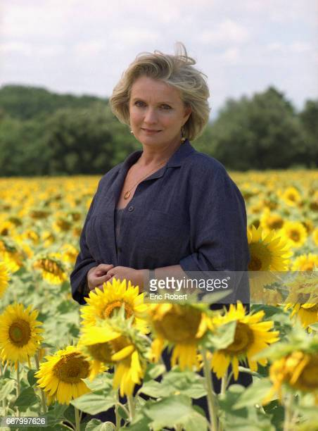 French actress MarieChristine Barrault stands in a field of sunflowers near the village of Grignan in the Drome region of France She is attending the...