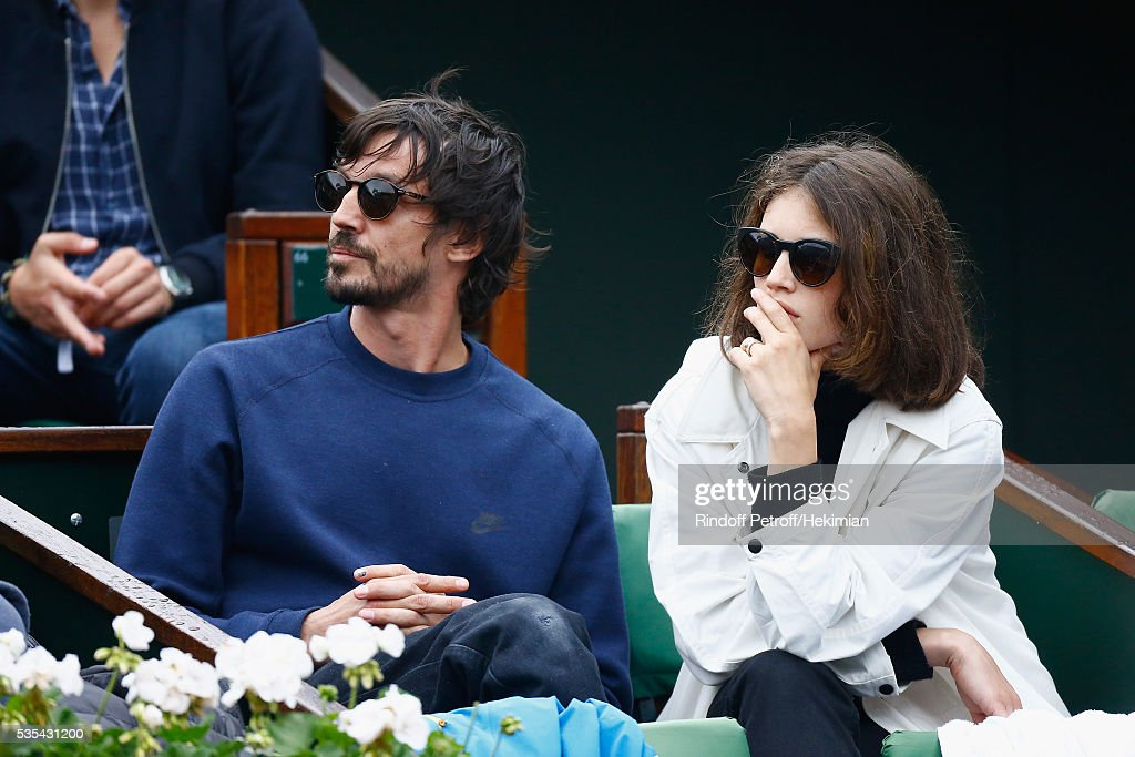 French actress <a gi-track='captionPersonalityLinkClicked' href=/galleries/search?phrase=Marine+Vacth&family=editorial&specificpeople=7496911 ng-click='$event.stopPropagation()'>Marine Vacth</a> and her husband Fashion Photographer Paul Schmidt attend the French Tennis Open Day 8 at Roland Garros on May 29, 2016 in Paris, France.
