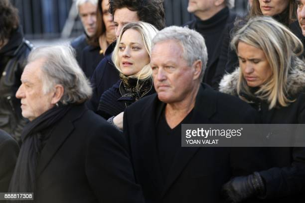 French actress Marion Cotillard and Andre Boudou father of Laeticia arrives to attend the funeral ceremony for late French singer Johnny Hallyday...