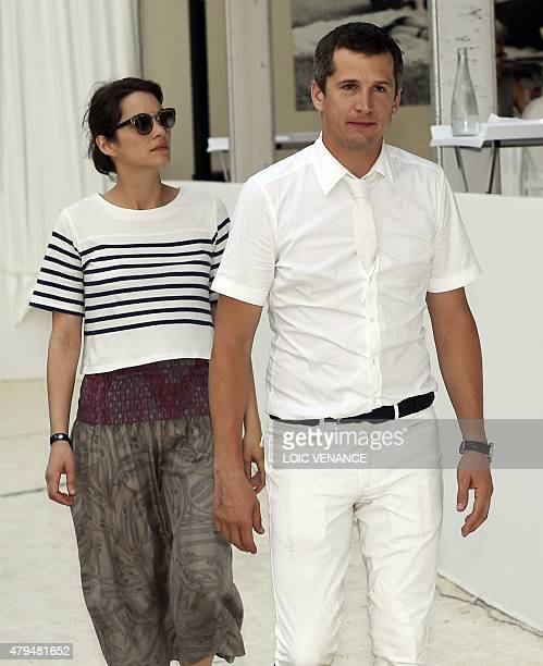 French actress Marion Cotillard and French film director and actor Guillaume Canet attend the Longines Global Champions Tour Grand Prix de Paris...