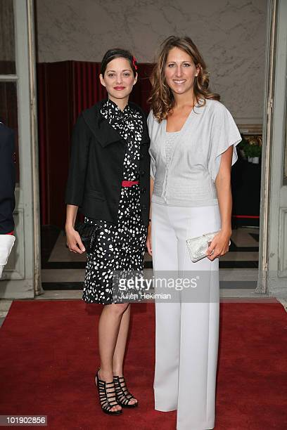 French actress Marion Cotillard and Maud Fontenoy attend the Maud Fontenoy's gala at Hotel de la Marine on June 8 2010 in Paris France