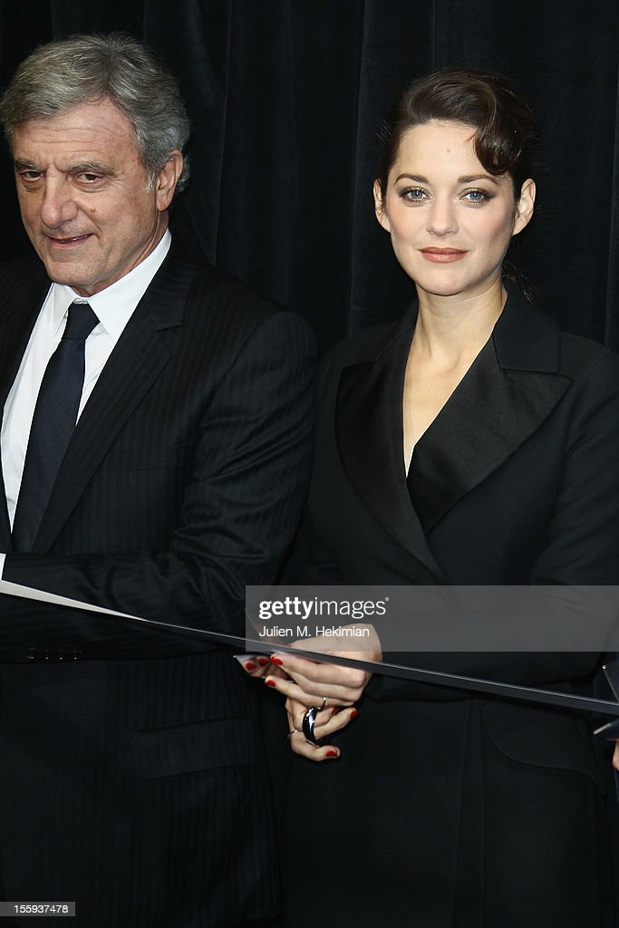French actress Marion Cotillard and Sydney Toledano launch the Christmas illuminations at Printemps Haussmann on November 9, 2012 in Paris, France.