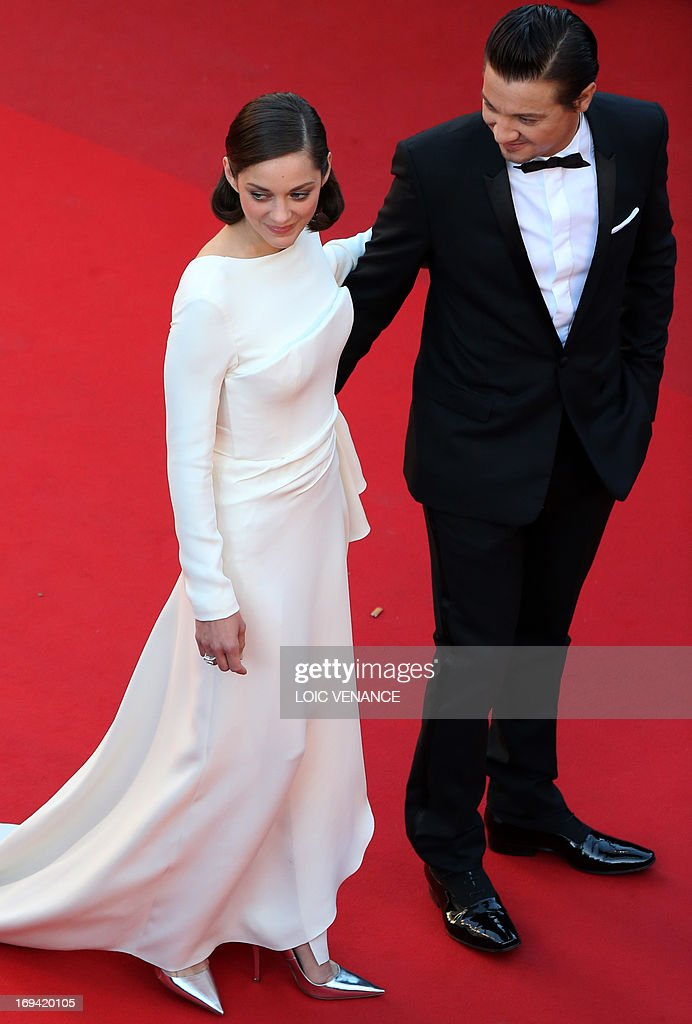 French actress Marion Cotillard (L) and US actor Jeremy Renner pose on May 24, 2013 as they arrive for the screening of the film 'The Immigrant' presented in Competition at the 66th edition of the Cannes Film Festival in Cannes. Cannes, one of the world's top film festivals, opened on May 15 and will climax on May 26 with awards selected by a jury headed this year by Hollywood legend Steven Spielberg.