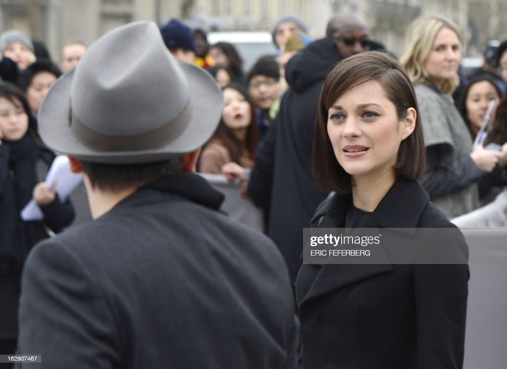 French actress Marion Cotillard arrives on March 1, 2013 to attend Christian Dior's Fall/Winter 2013-2014 ready-to-wear collection show in Paris.