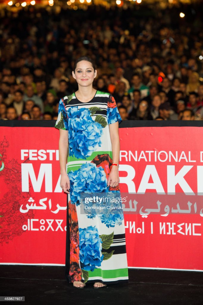 French actress <a gi-track='captionPersonalityLinkClicked' href=/galleries/search?phrase=Marion+Cotillard&family=editorial&specificpeople=215303 ng-click='$event.stopPropagation()'>Marion Cotillard</a> attends the 'Public Enemies' Presentation during the 13th Marrakech International Film Festival on December 5, 2013 in Marrakech, Morocco.