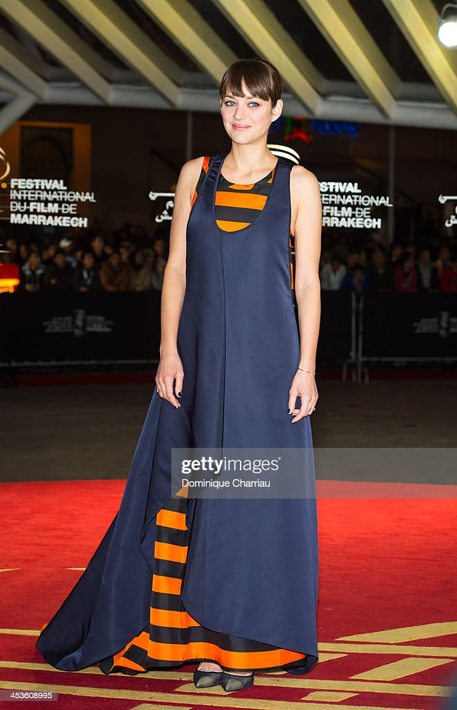 French actress <a gi-track='captionPersonalityLinkClicked' href=/galleries/search?phrase=Marion+Cotillard&family=editorial&specificpeople=215303 ng-click='$event.stopPropagation()'>Marion Cotillard</a> attends the 'Waltz With Monica' Premiere At 13th Marrakech International Film Festival on December 4, 2013 in Marrakech, Morocco.
