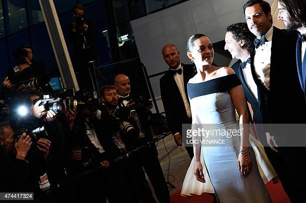 French actress Marion Cotillard French actor Guillaume Gallienne French actor Laurent Lafitte and French producer Dimitri Rassam pose before leaving...