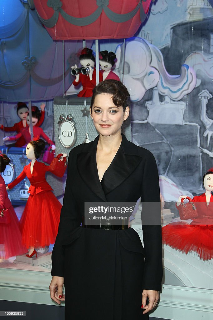 French actress <a gi-track='captionPersonalityLinkClicked' href=/galleries/search?phrase=Marion+Cotillard&family=editorial&specificpeople=215303 ng-click='$event.stopPropagation()'>Marion Cotillard</a> launches the Christmas illuminations at Printemps Haussmann on November 9, 2012 in Paris, France.