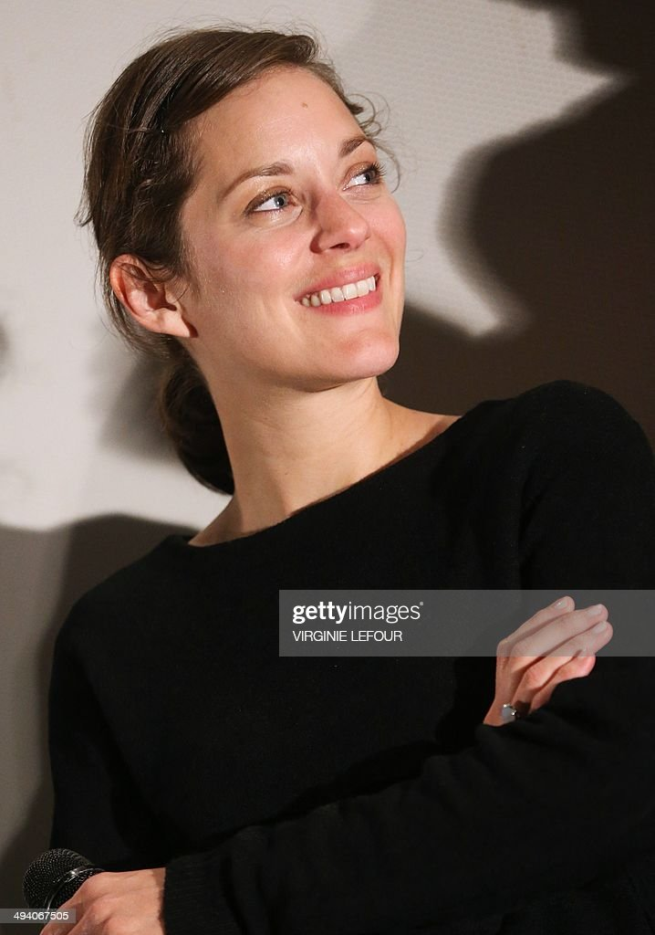 French actress Marion Cotillard pose for a photograph before a projection of the last Dardenne borthers movie 'Deux jours, Une nuit' ('Two days, one night'), which was part of the official Cannes 2014 film festival selection, on May 27, 2014, at the Kinepolis cinema complex, in Braine L'Alleud, Belgium.