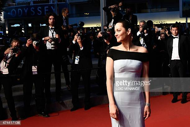 French actress Marion Cotillard poses before leaving the Festival palace after the screening of the film 'The Little Prince' at the 68th Cannes Film...