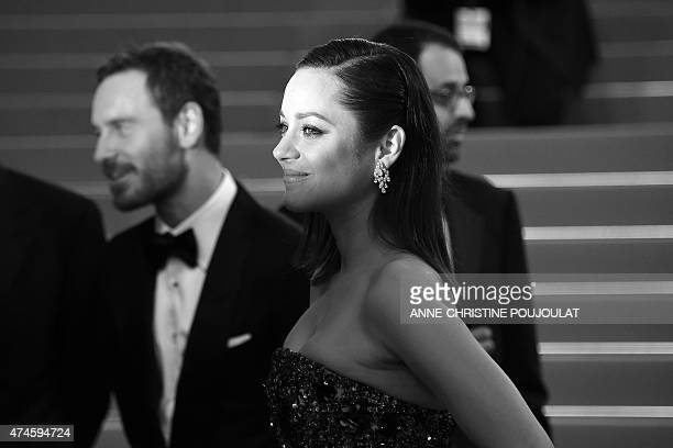 French actress Marion Cotillard poses before leaving the Festival palace after the screening of the film 'Macbeth' at the 68th Cannes Film Festival...