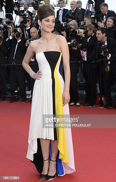 French actress Marion Cotillard poses on May 20 2013 as she arrives for the screening of the film 'Blood Ties' presented Out of Competition at the...