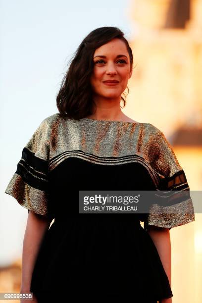 French actress Marion Cotillard poses on the red carpet on June 17 2017 during the Cabourg Romantic Film Festival in Cabourg northwestern France /...
