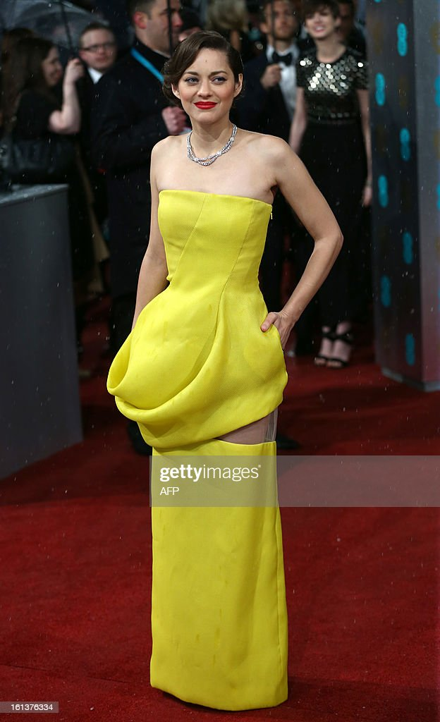 French actress Marion Cotillard poses on the red carpet upon arrival to attend the annual BAFTA British Academy Film Awards at the Royal Opera House in London on February 10, 2013.