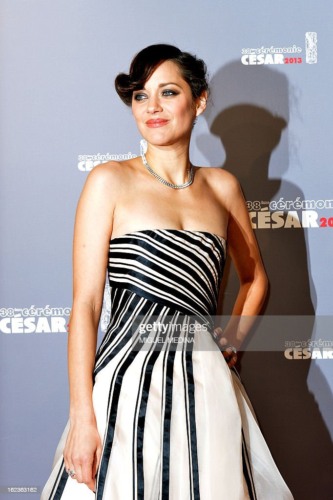French actress Marion Cotillard poses upon arrival to the 38th Cesar Awards ceremony on February 22, 2013 at the Chatelet theatre in Paris. AFP PHOTO / MIGUEL MEDINA