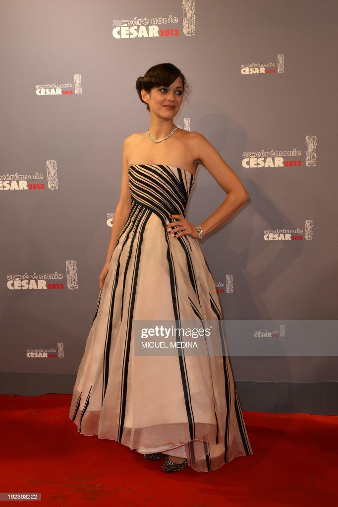French actress Marion Cotillard poses upon arrival to the 38th Cesar Awards ceremony on February 22, 2013 at the Chatelet theatre in Paris.