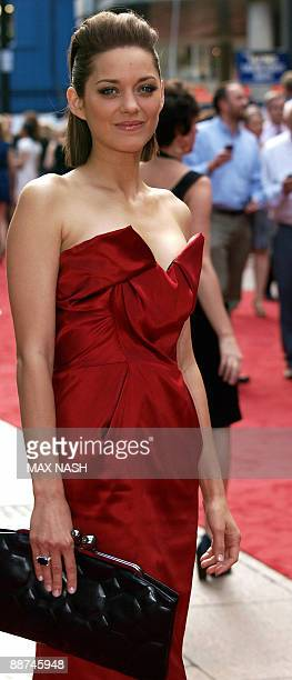 French actress Marion Cotillard smiles on her arrival at London's Leicester Square to attend the British Premiere of her latest film 'Public Enemies'...