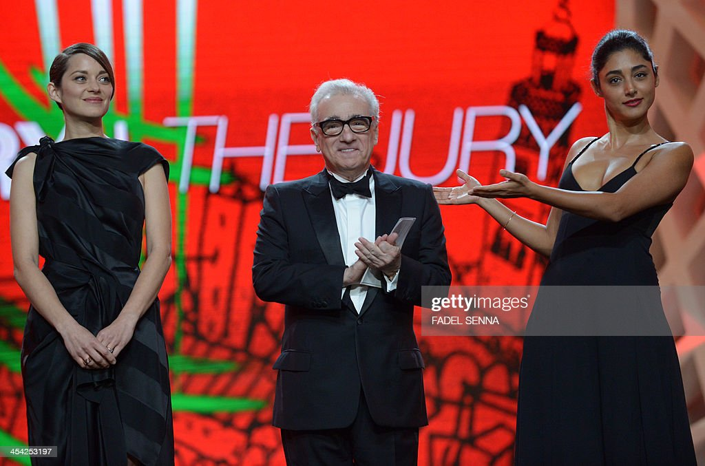 French actress Marion Cotillard (L) stands next to director Martin Scorsese and Iranian actress Golshifteh Farahani during the closing ceremony of the 13th Marrakech International Film Festival on December 7, 2013 in Marrakech.