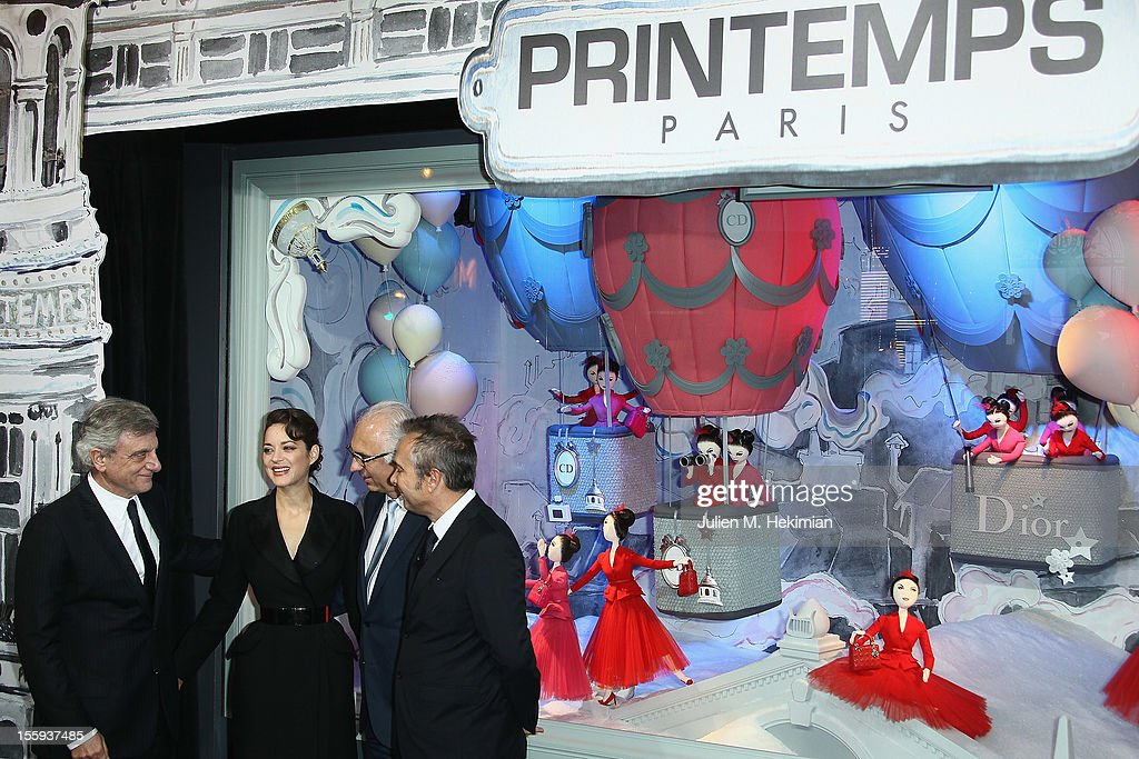 French actress Marion Cotillard, Sydney Toledano (R) and guests launch the Christmas illuminations at Printemps Haussmann on November 9, 2012 in Paris, France.