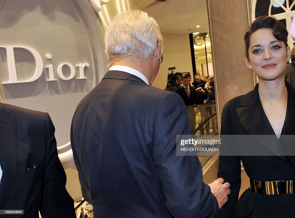 French actress Marion Cotillard walks inside the Printemps department store during the inauguration of the new Christmas window displays on November 9, 2012, in Paris.