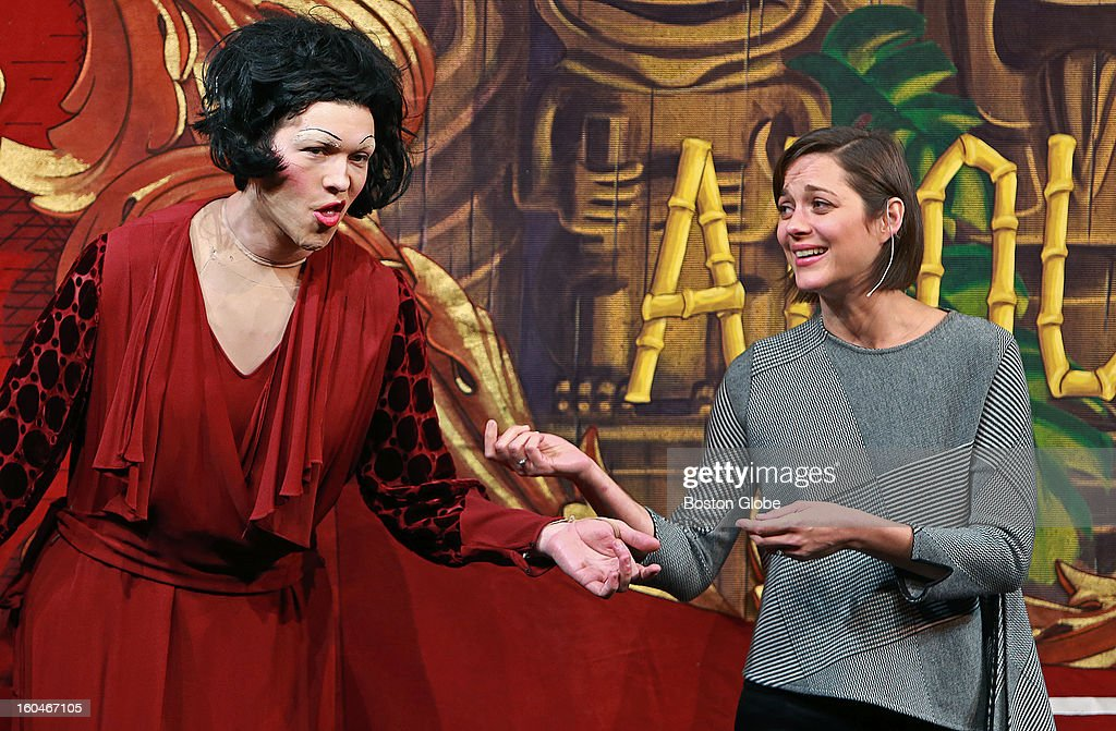 French actress Marion Cotillard was named the 2013 Hasty Pudding Theatricals Woman of the Year today. She rode in a convertible for the traditional parade through the streets near Harvard Square. She then was roasted on stage in Farkas Hall, where she was presented with the coveted pudding pot. Here she 'sings' with Ethan Hardy, left, who is portraying Edith Pilaf.
