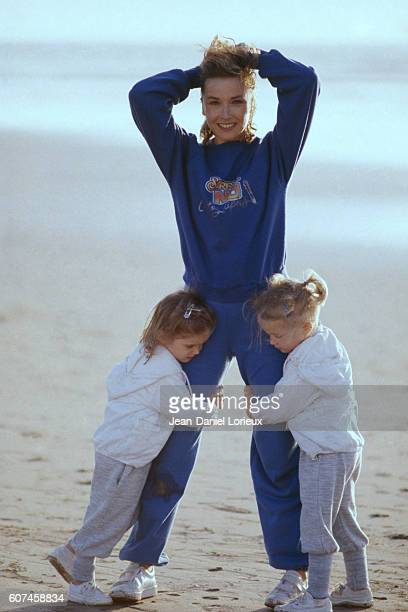 French actress Marlene Jobert with her twin daughters Eva and Joy