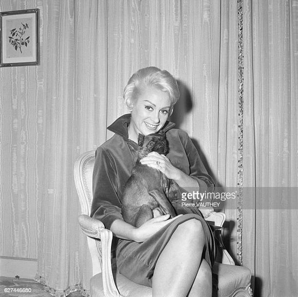 French Actress Martine Carol Holding Pug