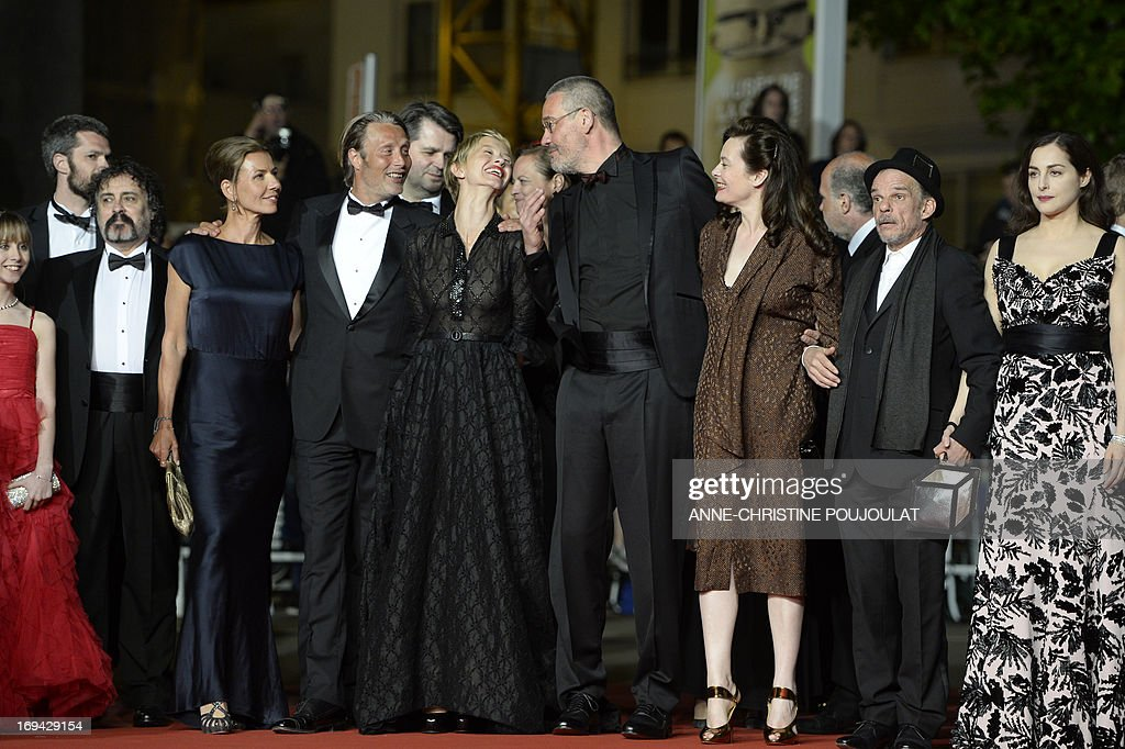 French actress Melusine Mayance, a guest, Danish actor Mads Mikkelsen and his wife Hanne Jakobsen, French actress Delphine Chuillot, French director Arnaud des Pallieres and his partner, French actor Denis Lavant and actress Amira Casar pose on May 24, 2013 as they arrive for the screening of the film 'Michael Kohlhaas' presented in Competition at the 66th edition of the Cannes Film Festival in Cannes. Cannes, one of the world's top film festivals, opened on May 15 and will climax on May 26 with awards selected by a jury headed this year by Hollywood legend Steven Spielberg. AFP PHOTO / ANNE-CHRISTINE POUJOULAT