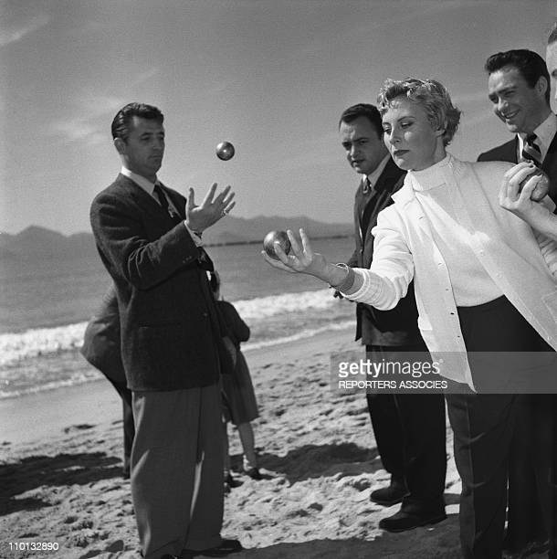 French actress Michele Morgan is playing French 'petanque' game with Robert Mitchum during the International Film Festival in Cannes Southern France...