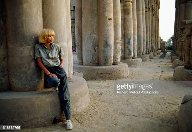 French Actress Mireille Darc stands in the peristyle couryard at the Temple of Luxor