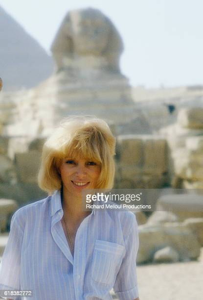 French Actress Mireille Darc stands near the Great Sphinx during a visit to Giza