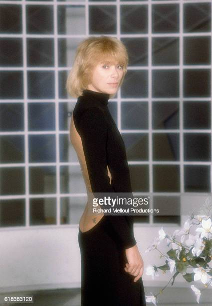 French actress Mireille Darc wears a backless dress during the taping of the Numero 1 television show The program was produced by Maritie and Gilbert...