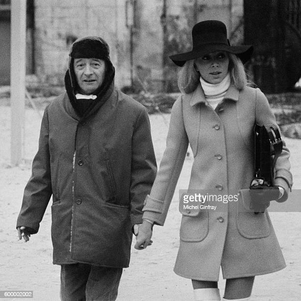 French actress Mireille Darc with director and screenwriter Michel Audiard on the set of his movie Elle boit pas elle fume pas elle drague pas mais...