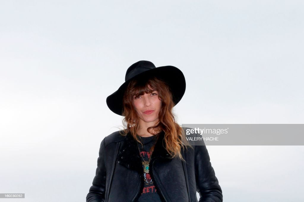 French actress, model and musician Lou Doillon poses during a photocall as part of the music world's largest annual trade fair, Midem, on January 28, 2013 in Cannes, southeastern France. The Midem music trade show will bring 7,000 of the global industry's biggest players together on the French Riviera for four days. AFP PHOTO / VALERY HACHE