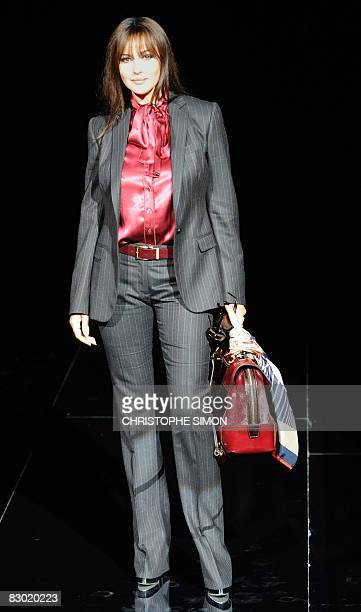 French actress Monica Belluci poses prior the Dolce Gabbana fashion show as part of the women's Spring/Summer 2009 readytowear collections of the...
